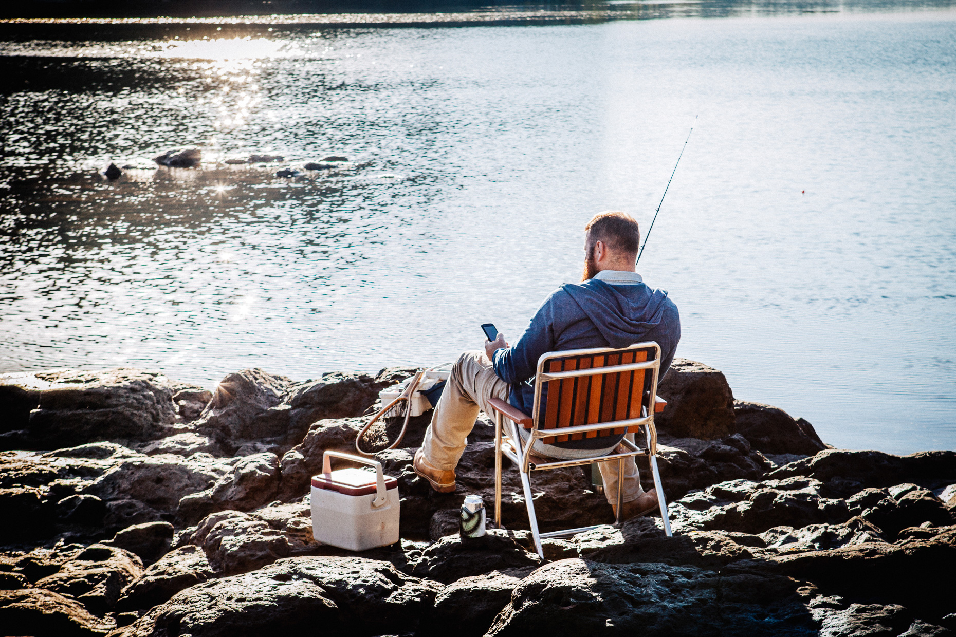 Man Fishing with Beer, Chair and a Smart Phone